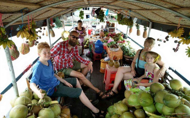 Tourist visit Tra On floating market on boat