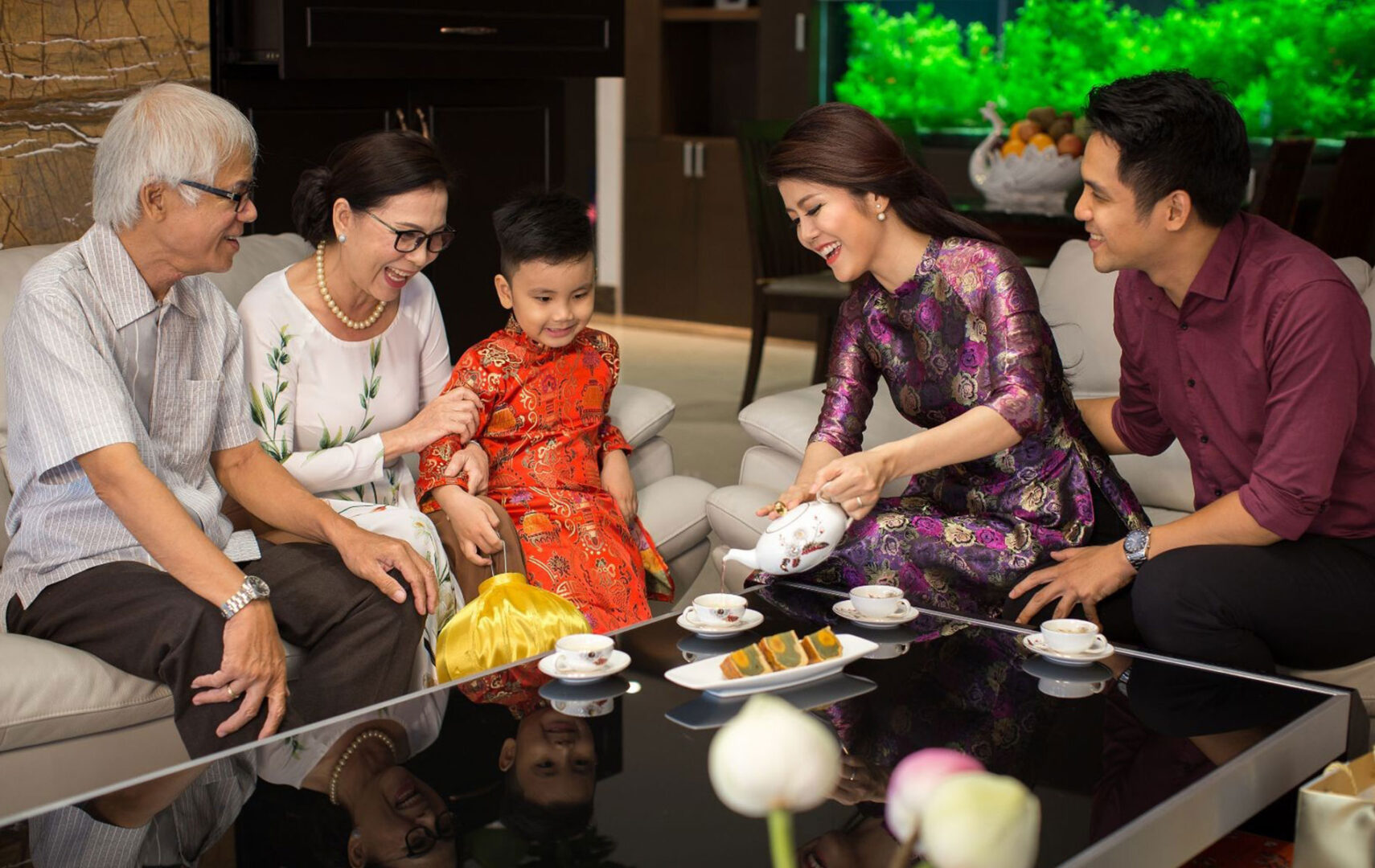In mid-Autumn festival, Vietnamese family gathers with moon cakes and cups of hot tea.
