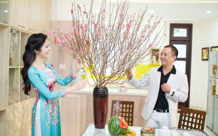 Locals prepare for Tet Holiday with a bunch of lucky Vietnamese flowers.