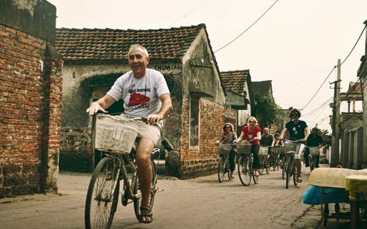 Biking on countryside lane at Duong Lam Ancient Village