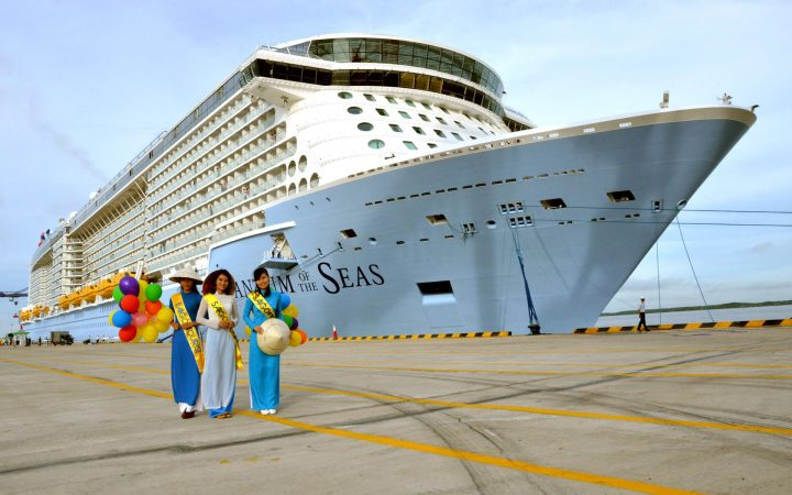 Beautiful Vietnamese ladies in Ao Dai welcome international passengers from world-class Quantum of the Seas cruise ship during its call in Phu My Port.