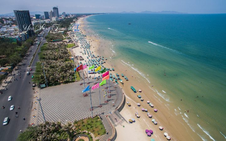 Vung Tau Back Beach features high-end hotels, restaurants and beach clubs, as well as lines of umbrellas and sunbathing chairs rent by local vendors.