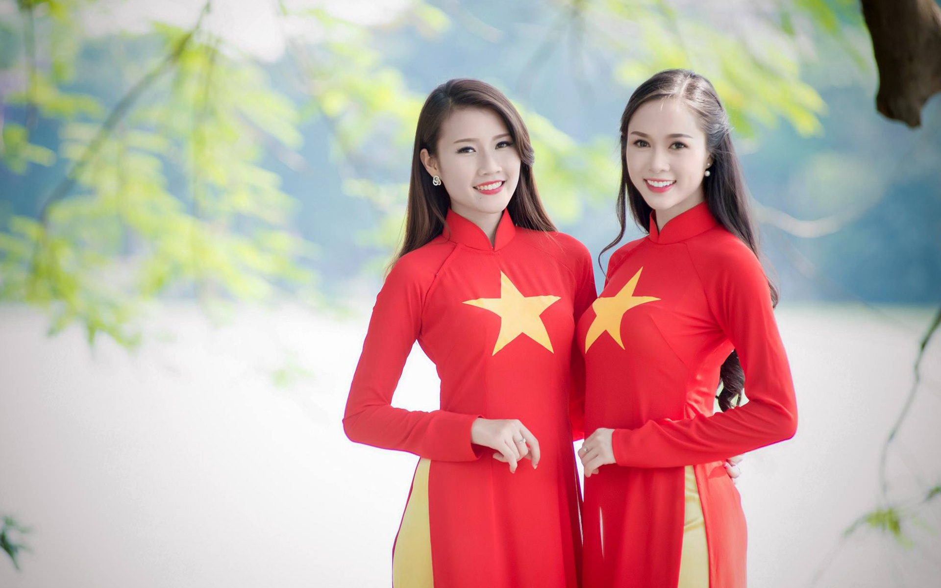 "Vietnamese women wearing special ""Ao Dai"" and taking photos"