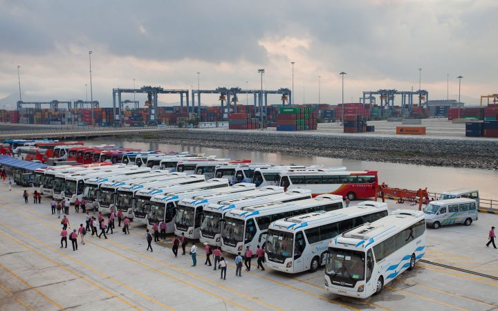 Tour buses park in assigned parking areas to wait for cruise ship's passengers and send them to shore excursions.
