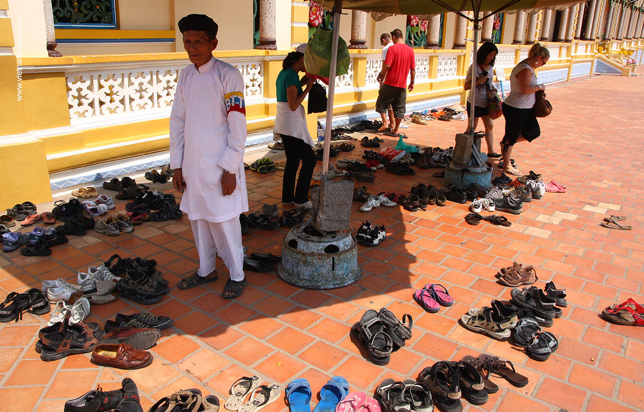 Shoes off for entry Cao Dai temple