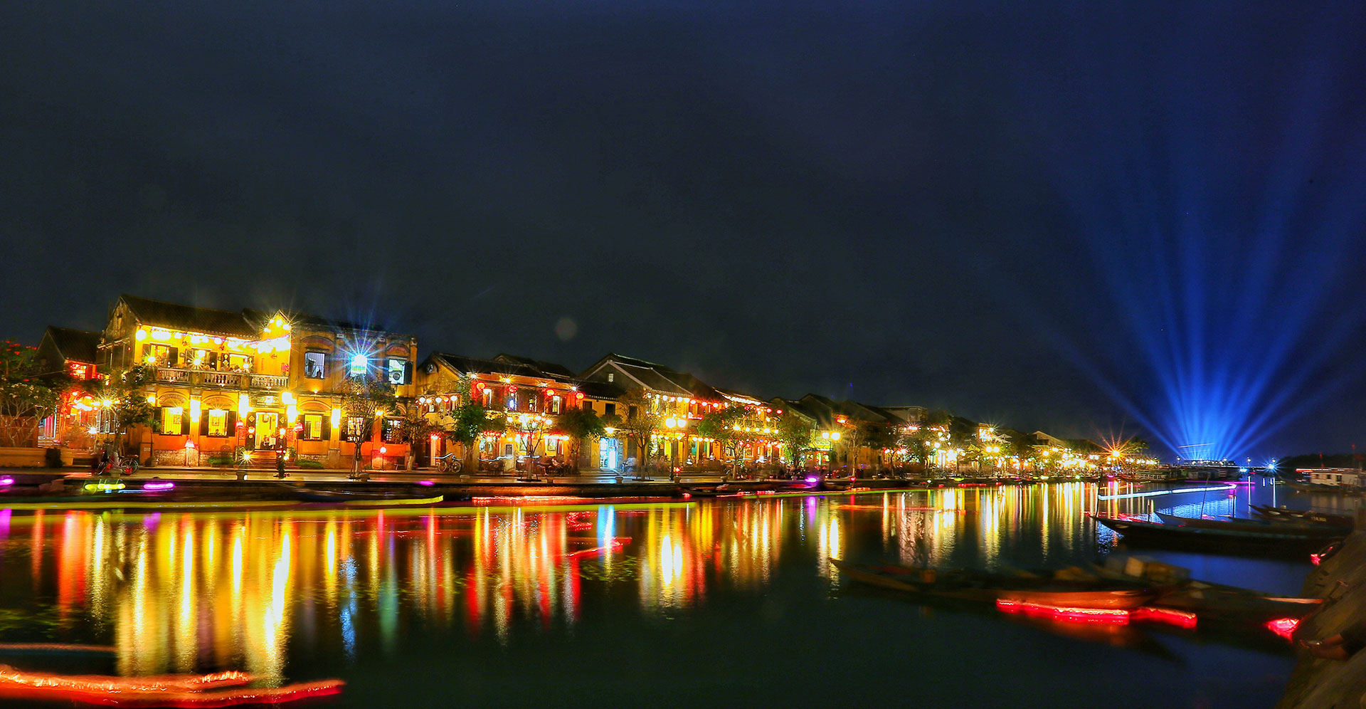 Colorful Hoi An along the river by night.