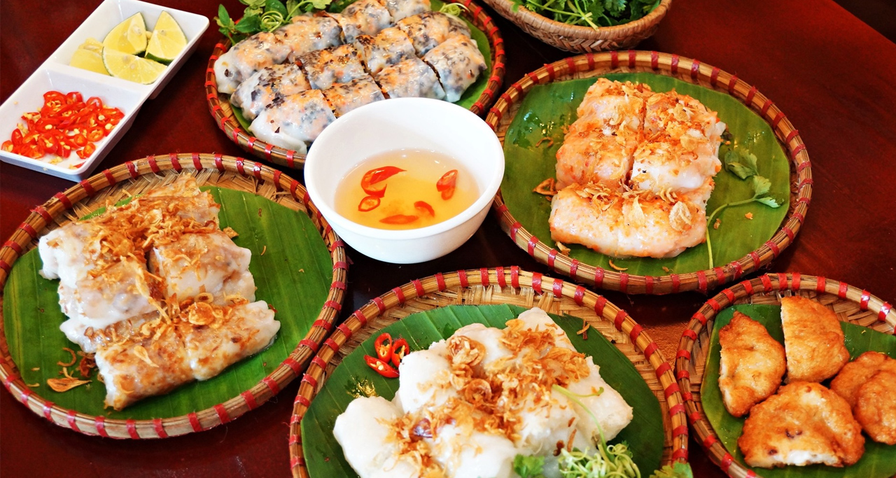 "Savory Rolled Cakes or ""banh cuon"" is served with dipping fish sauce"