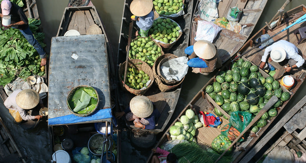 Fruits and vegetables are loaded in the boats for trading in floating markets