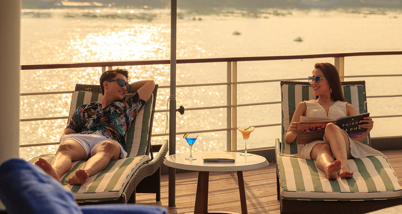 Tourists enjoy stunning sunset on a Mekong Cruise - an interesting experience