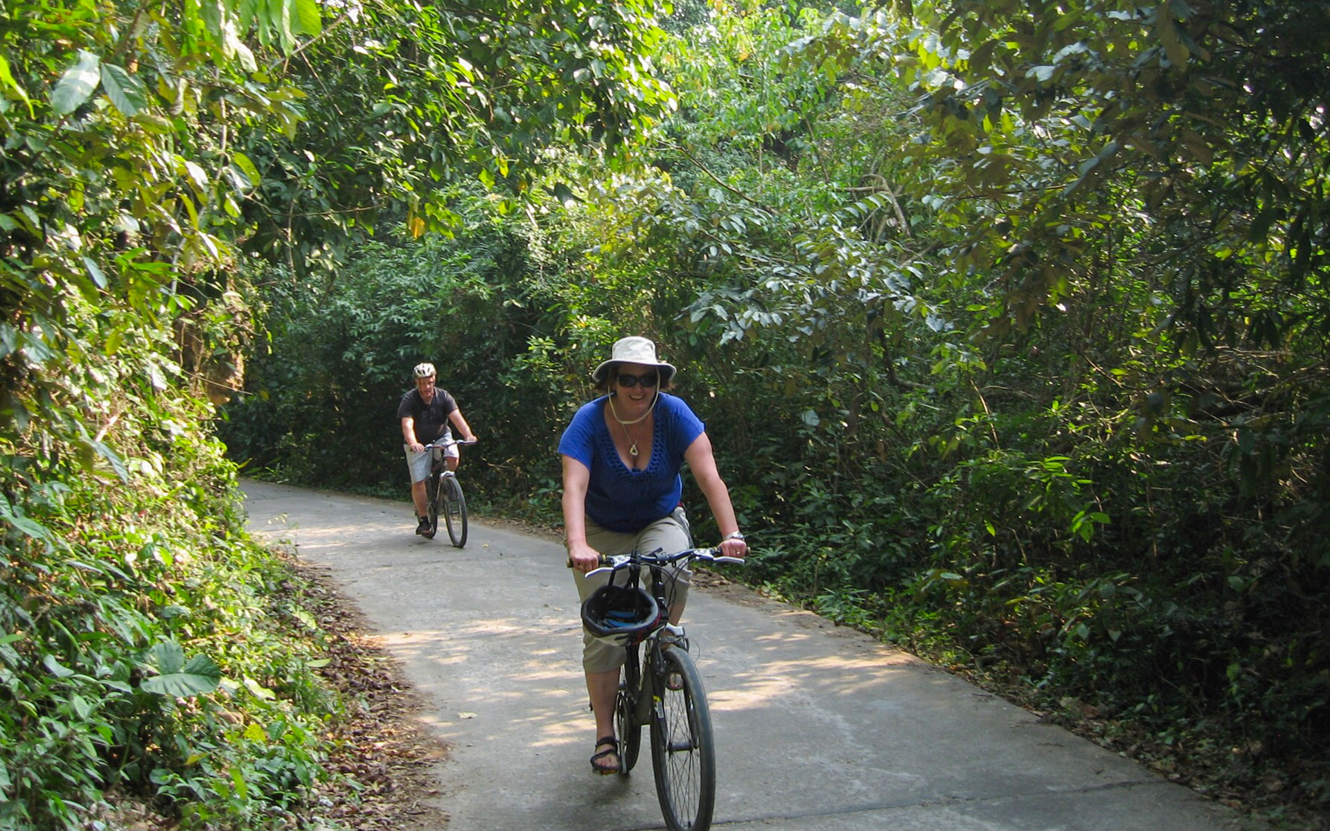 Tourists are cycling in Cat Ba National Park, recognized as the World Biosphere Reserve by UNESCO