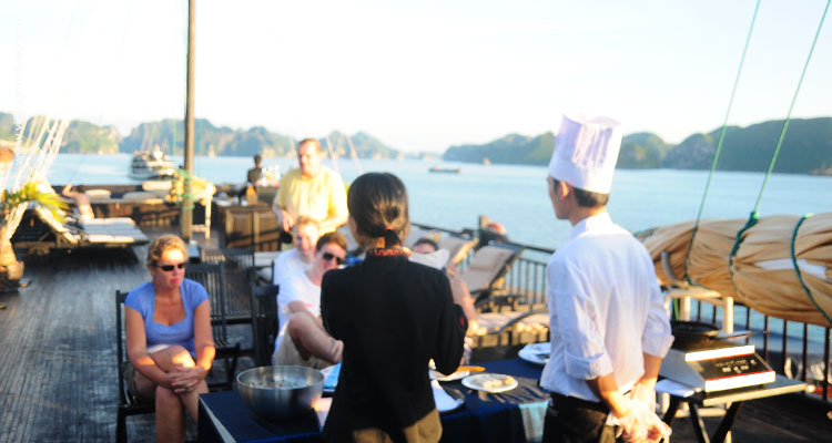 A cooking demonstration on one of Halong Bay overnight cruise